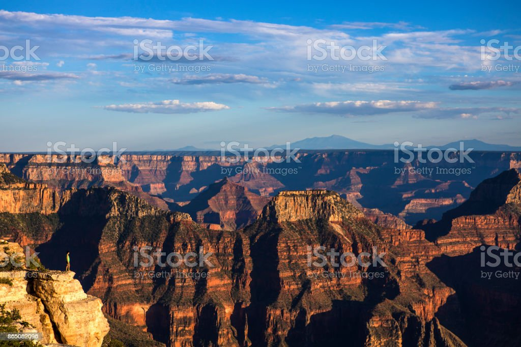 A Young Man Standing at the Edge of Grand Canyon royalty-free stock photo