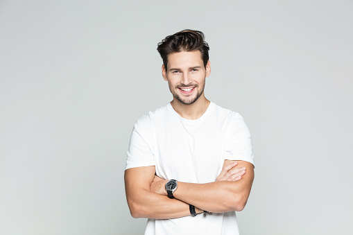 istock Young man standing confidently 973481352