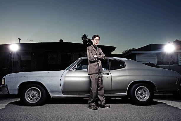 Young Man Standing Near Car stock photo