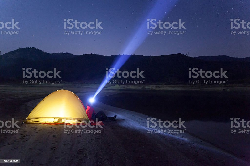 Young man Standing  night sky and beam of light royalty-free stock photo