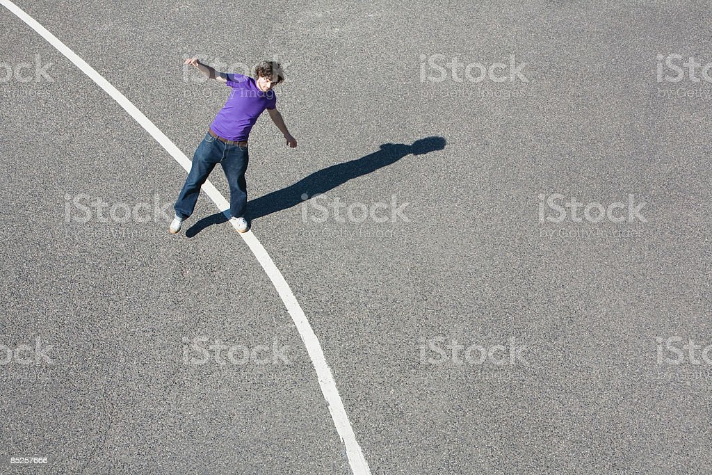 Young man standing on a line royalty-free stock photo