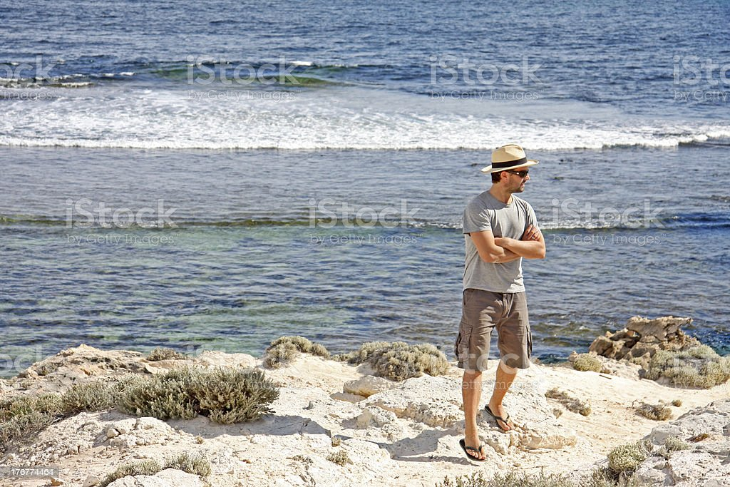 Young man standing on cliff royalty-free stock photo