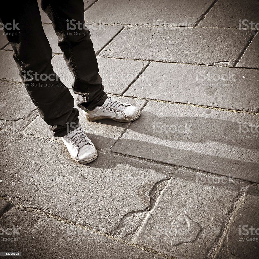 Young Man Standing on Old Stone Flooring, Firenze stock photo