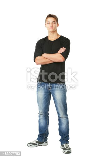Full length portrait of young man standing with hands folded against isolated on white background