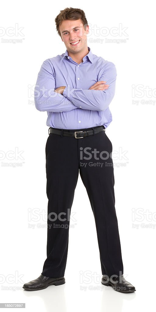 Young Man Standing With Crossed Arms royalty-free stock photo