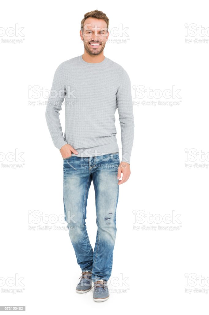 Young man standing with hands in pocket stock photo
