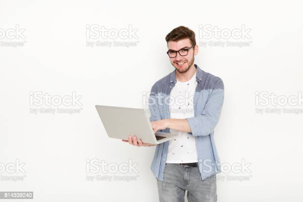 Young man standing with laptop picture id814339240?b=1&k=6&m=814339240&s=612x612&h=s5ufzlbso2 fbxl8rmvaukounnxuamh5jznfiasepae=