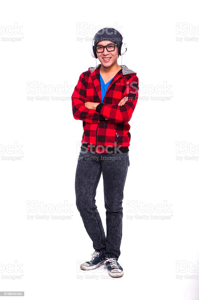 Young man standing with music headphones stock photo