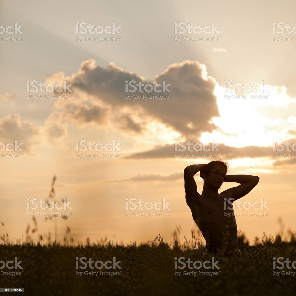 Young man stay in the rural landscape royalty-free stock photo