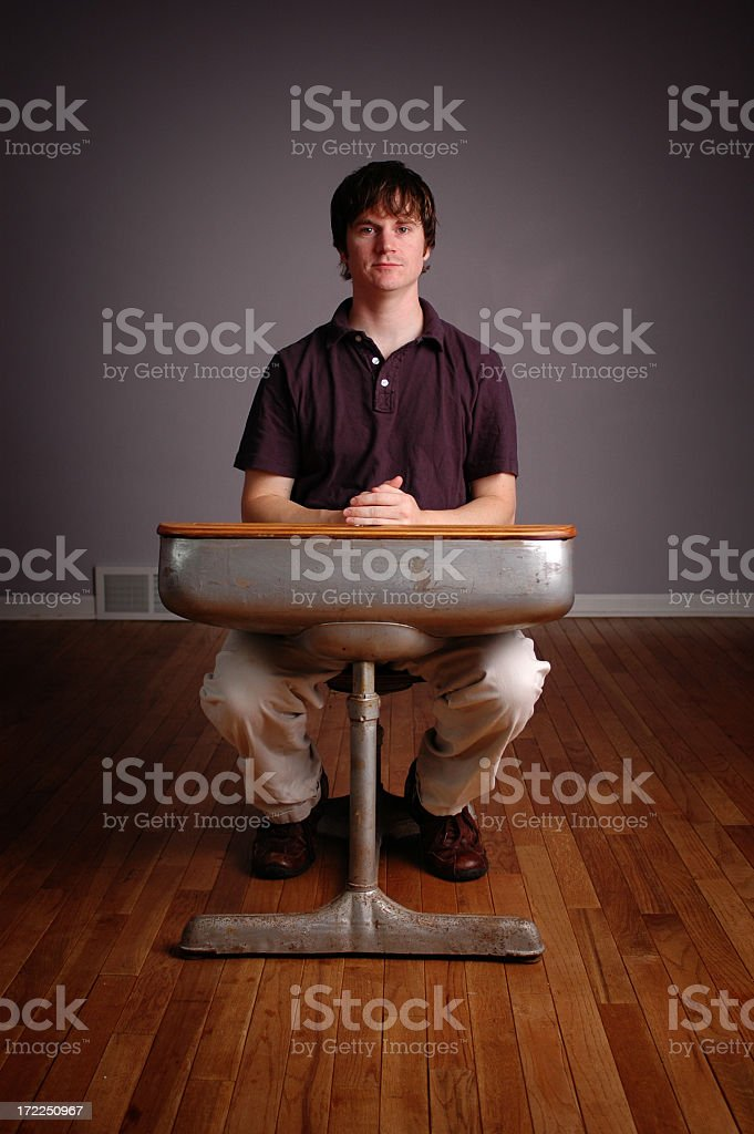 Young Man Student Sitting in Old School Desk royalty-free stock photo