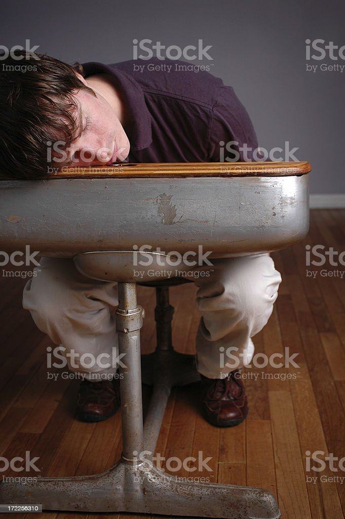 Young Man Student Sleeping in Old School Desk royalty-free stock photo