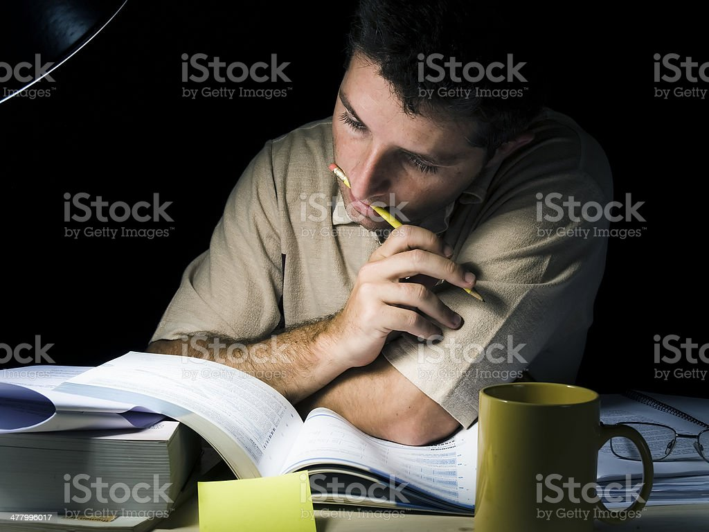 Young Man Studying at Night stock photo