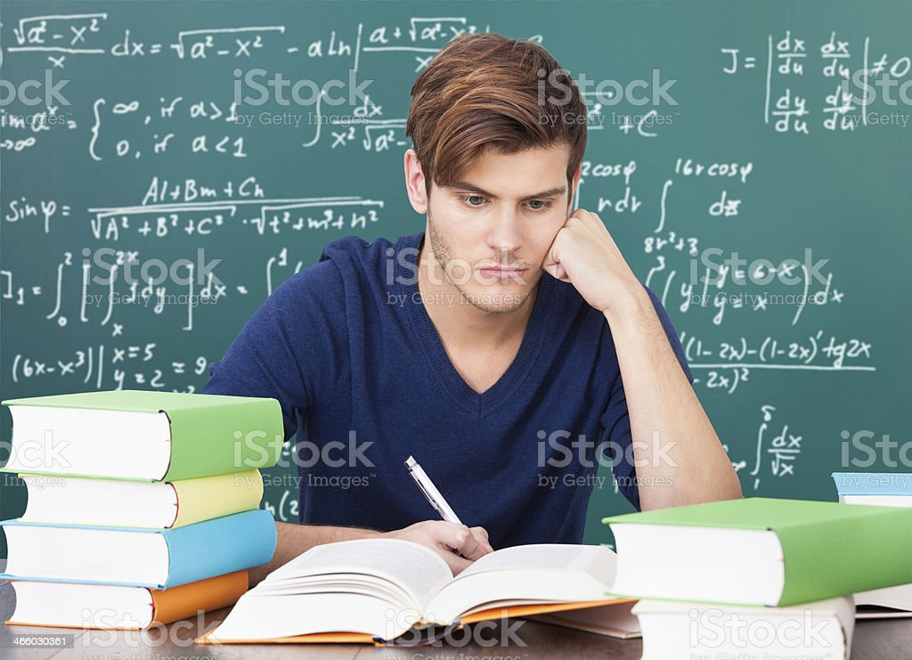 Young Man Studying In Classroom royalty-free stock photo