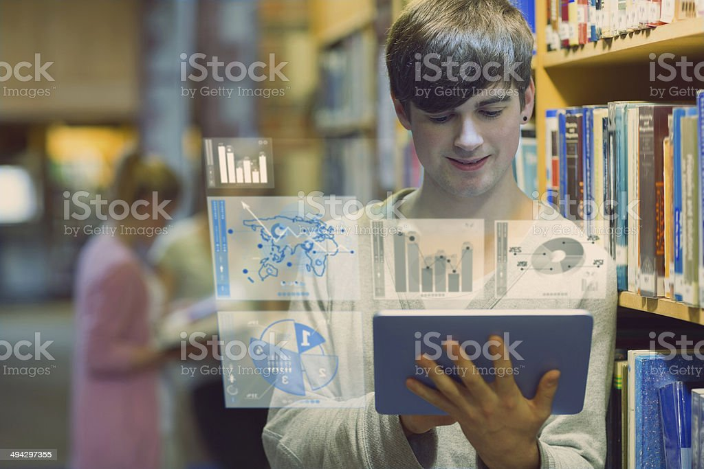 Young man studying on his digital tablet computer stock photo