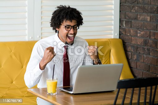 888751614 istock photo Young man success celebration at office 1130765790