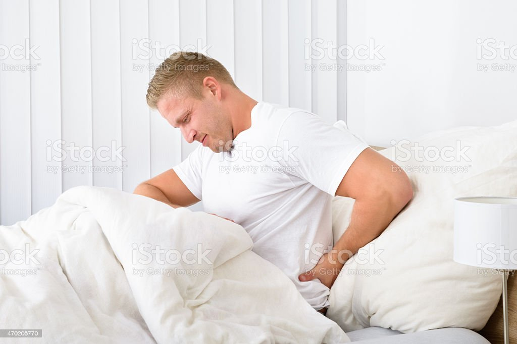 Young Man Suffering From Backpain stock photo