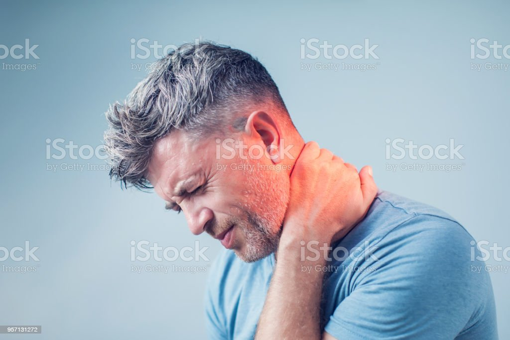 Young man suffering from neck pain. Headache pain. royalty-free stock photo