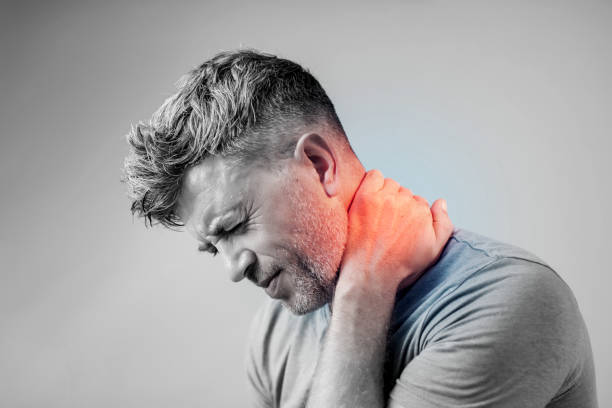 Young man suffering from neck pain. Headache pain. Young man suffering from neck pain. Headache pain. human neck stock pictures, royalty-free photos & images