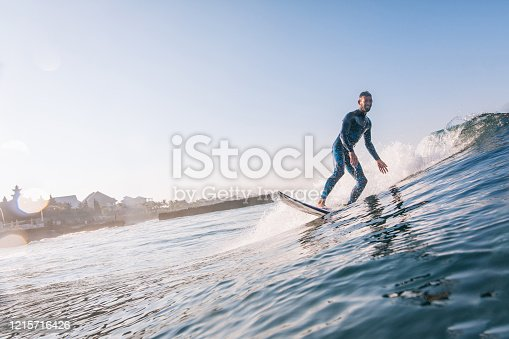 Young man surfing