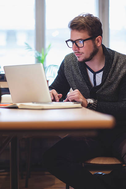 Young man surfing the internet stock photo