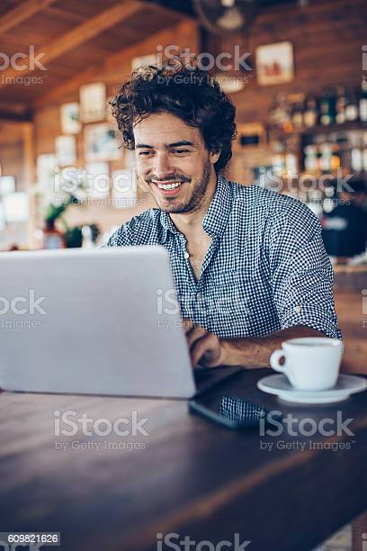 Young man surfing the net in cafe picture id609821626?b=1&k=6&m=609821626&s=612x612&h=u3yozv2vszdargwjurhpc2o2w5 k17cp8putjsdb5bk=