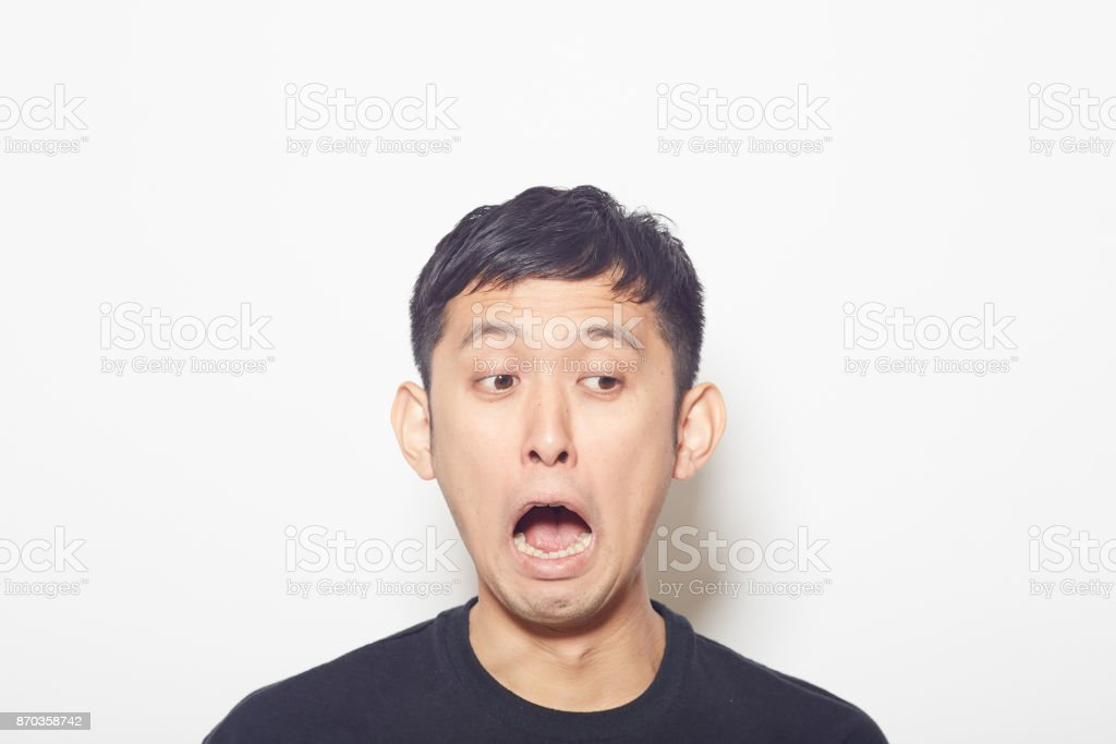 young man surprised at something stock photo