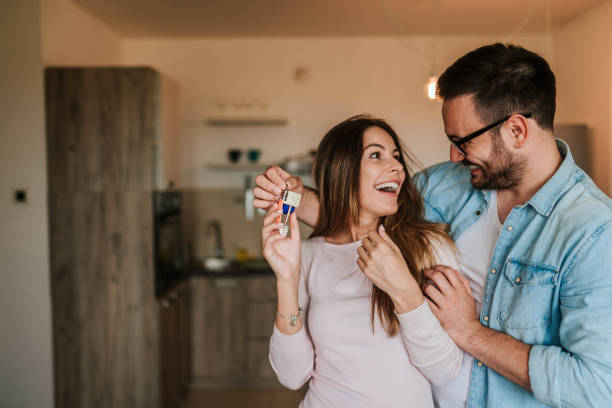 young man surprising his wife or a girl with new a apartment. - house hunting stock photos and pictures