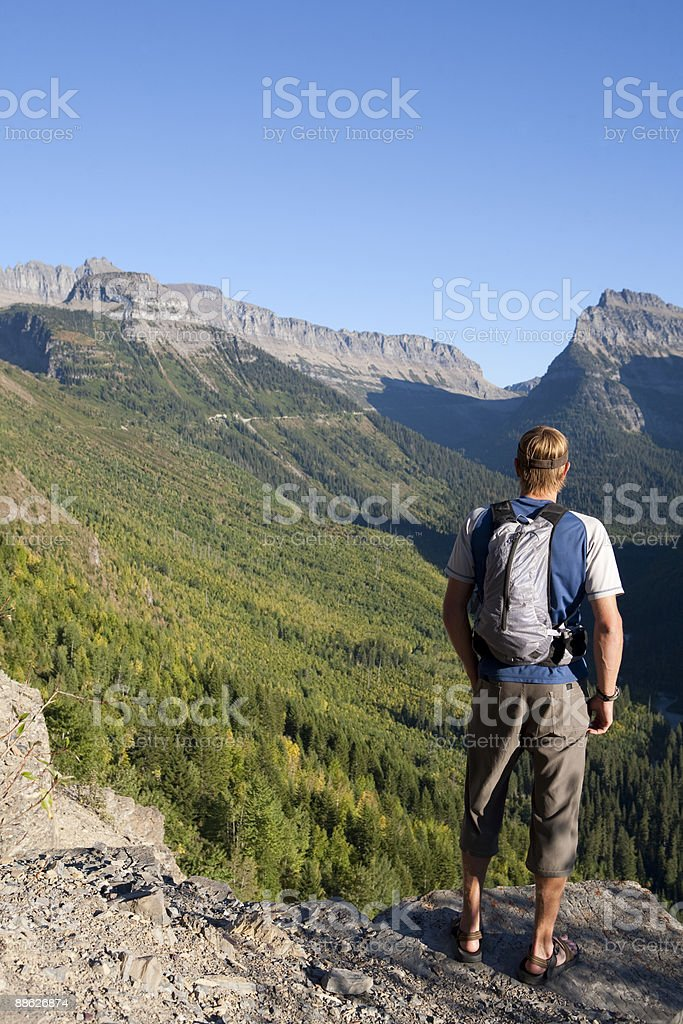 A young man takes in a mountainous view. royalty-free stock photo