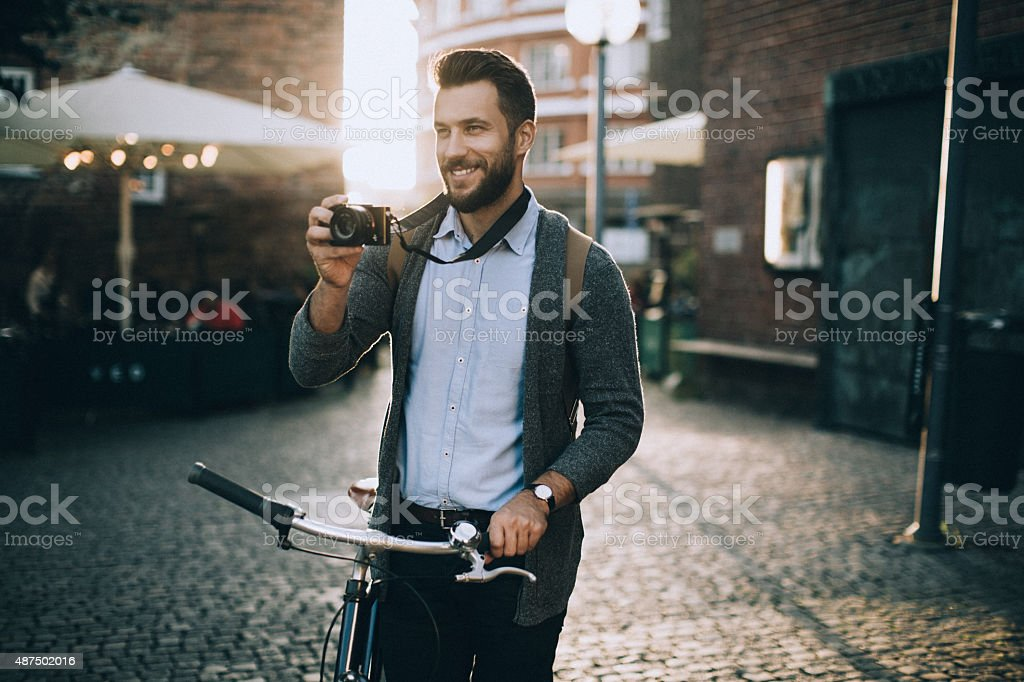 Young man taking a photo stock photo