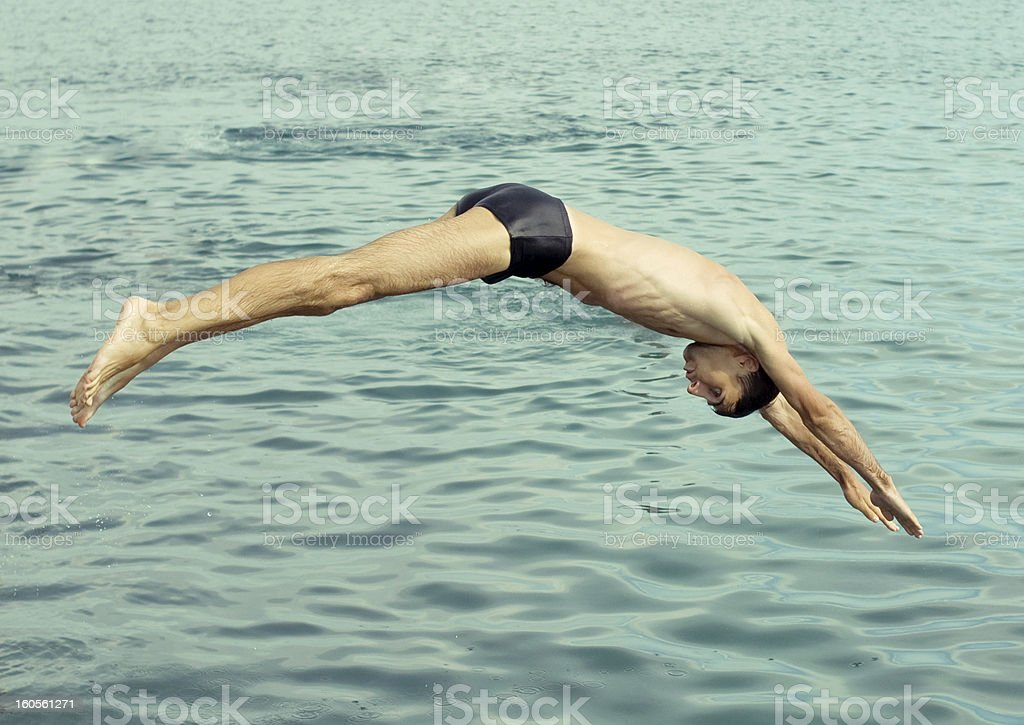 Young man taking a plunge stock photo
