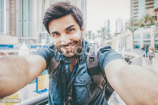 istock Young man taking a selfie 471372954