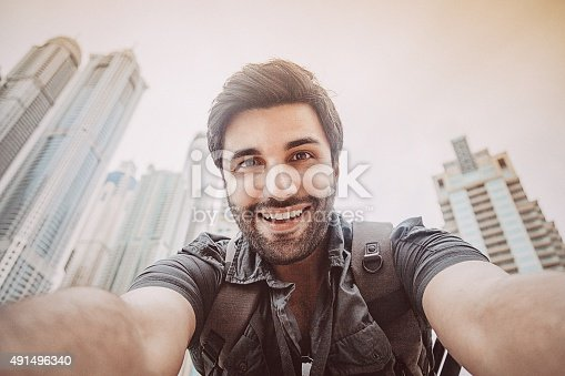 istock Young man taking a selfie 491496340