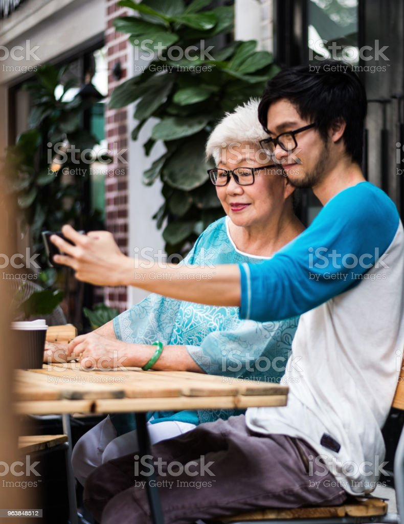 Young man taking a selfie with older women - Royalty-free Active Seniors Stock Photo