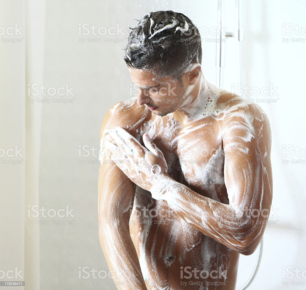 Young man taking a shower. royalty-free stock photo