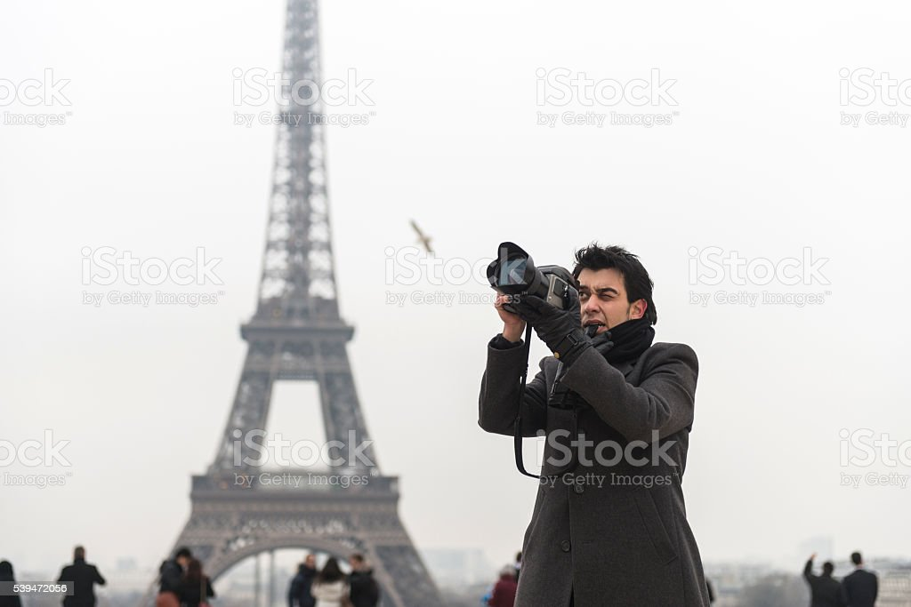 Young man taking pictures in Paris stock photo