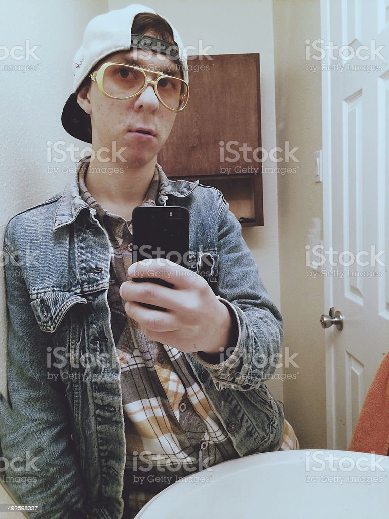 Young Man Taking Selfie in Bathroom Mirror stock photo