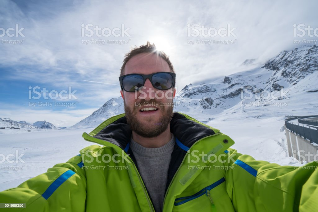 Young man taking selfie in winter stock photo