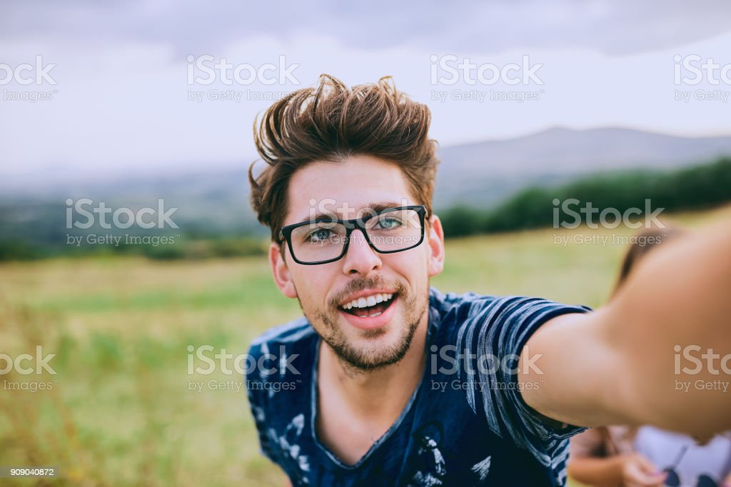 Young man taking selfie. stock photo