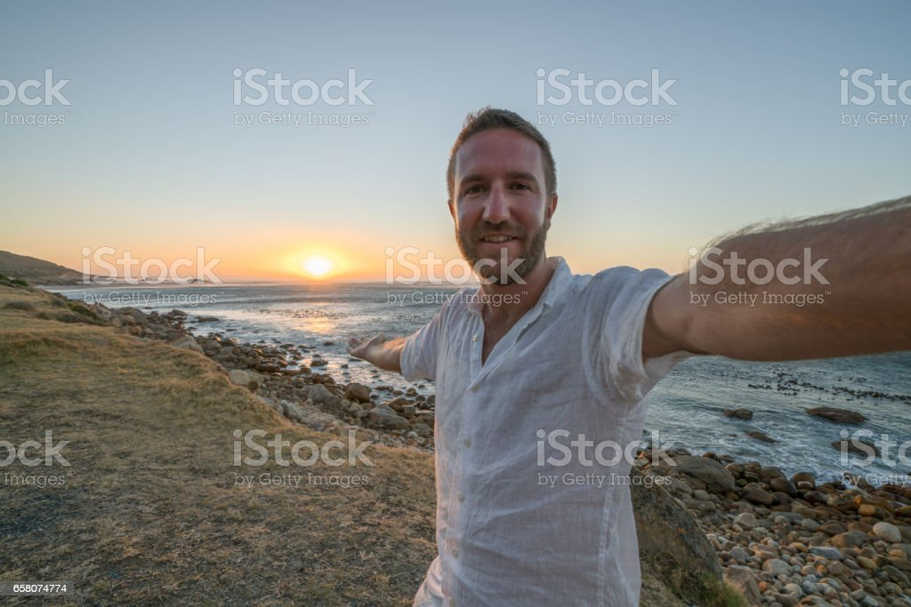 Young man taking selfie with sea view royalty-free stock photo