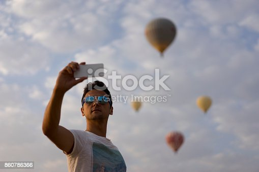 istock Young man taking selfie with smartphone 860786366