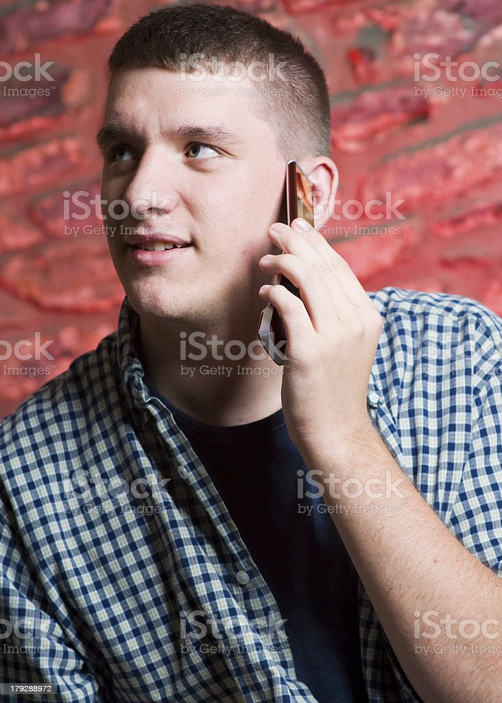 Young Man Talking on Cell Phone royalty-free stock photo