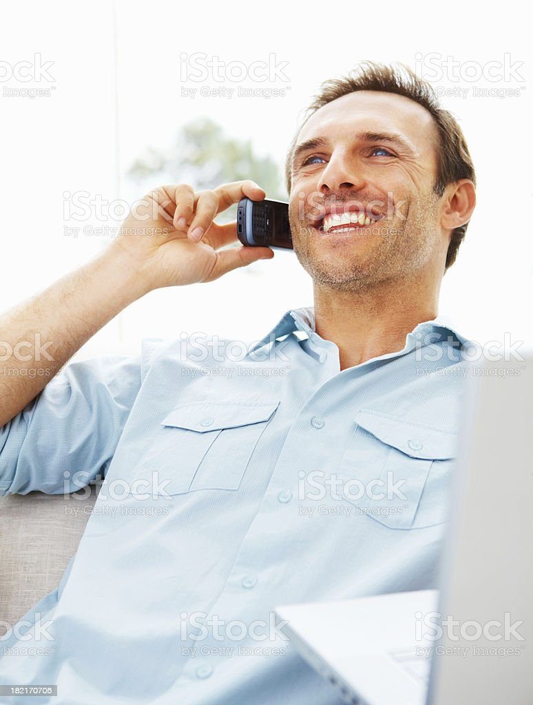 Young man talking on cellphone royalty-free stock photo