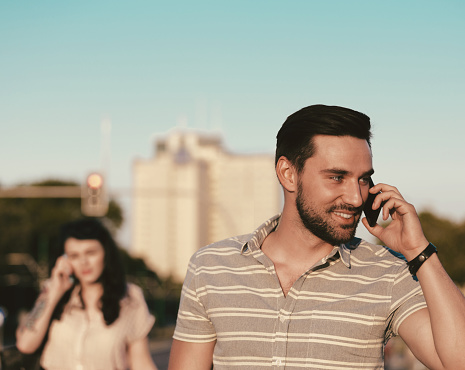 Young Man Talking On Phone Outdoor Stock Photo - Download Image Now