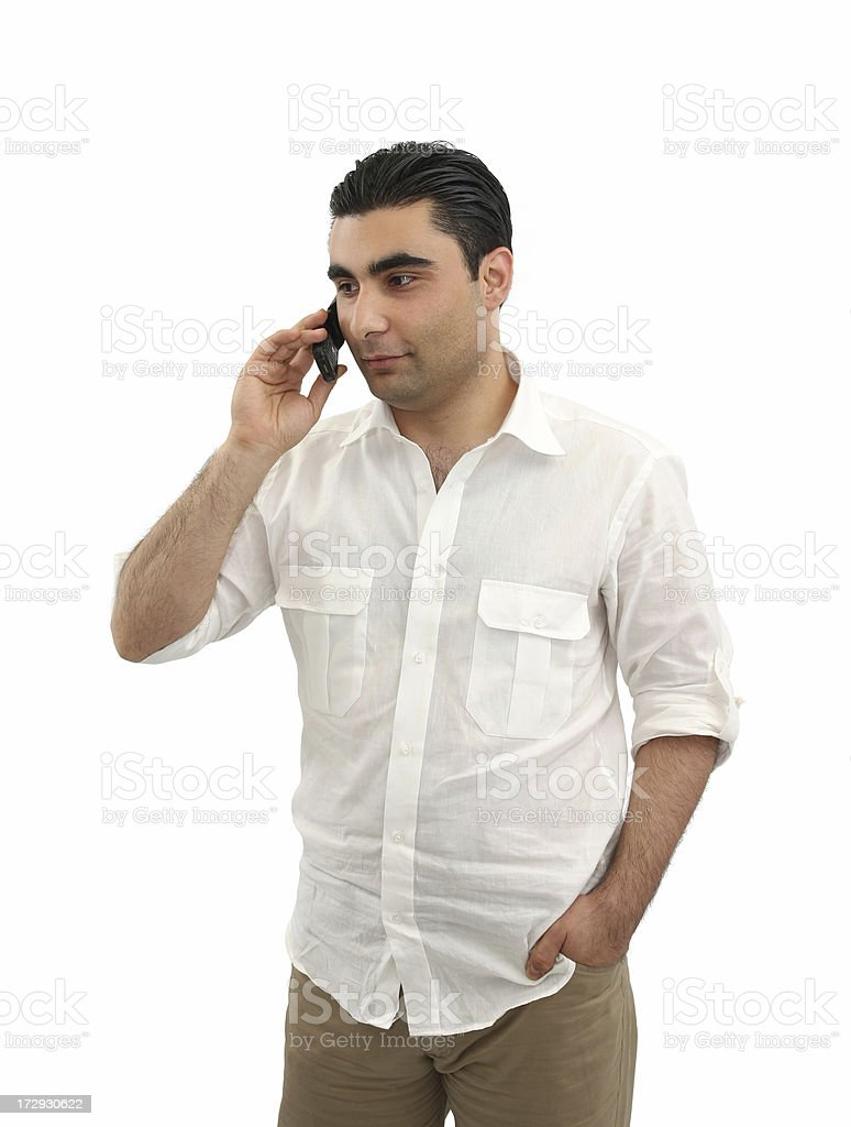 Young Man Talking On The Cell Phone Young man talking on the cell phone with white background. Adult Stock Photo