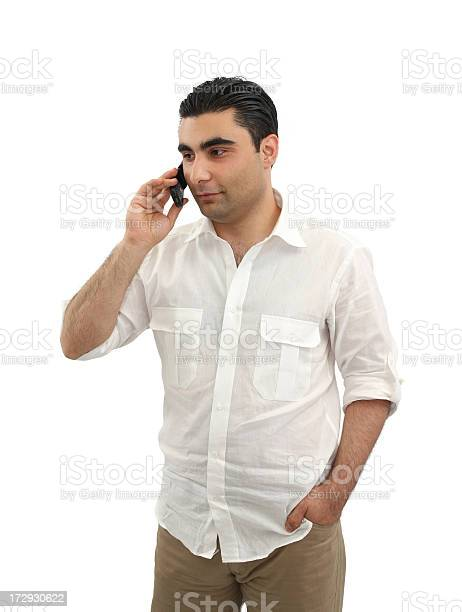 Young Man Talking On The Cell Phone Stock Photo - Download Image Now