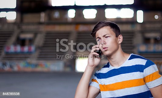 istock young man talking on the phone in the old building 848285538