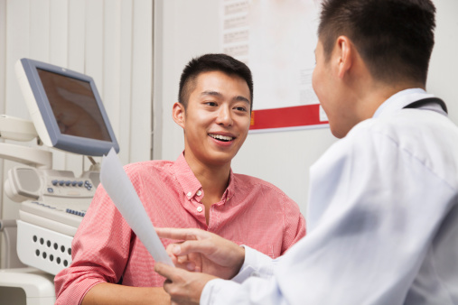 istock Young Man Talking With Doctor 456748545