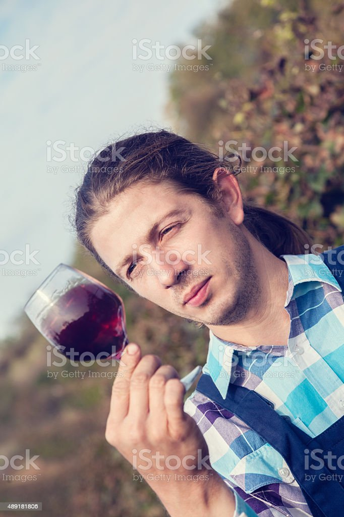 Young Man Tasting Wine stock photo