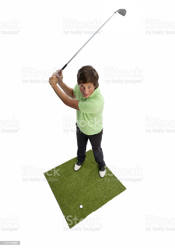 young man teeing off on golf course royalty-free stock photo