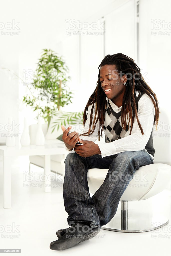Young man text messaging royalty-free stock photo